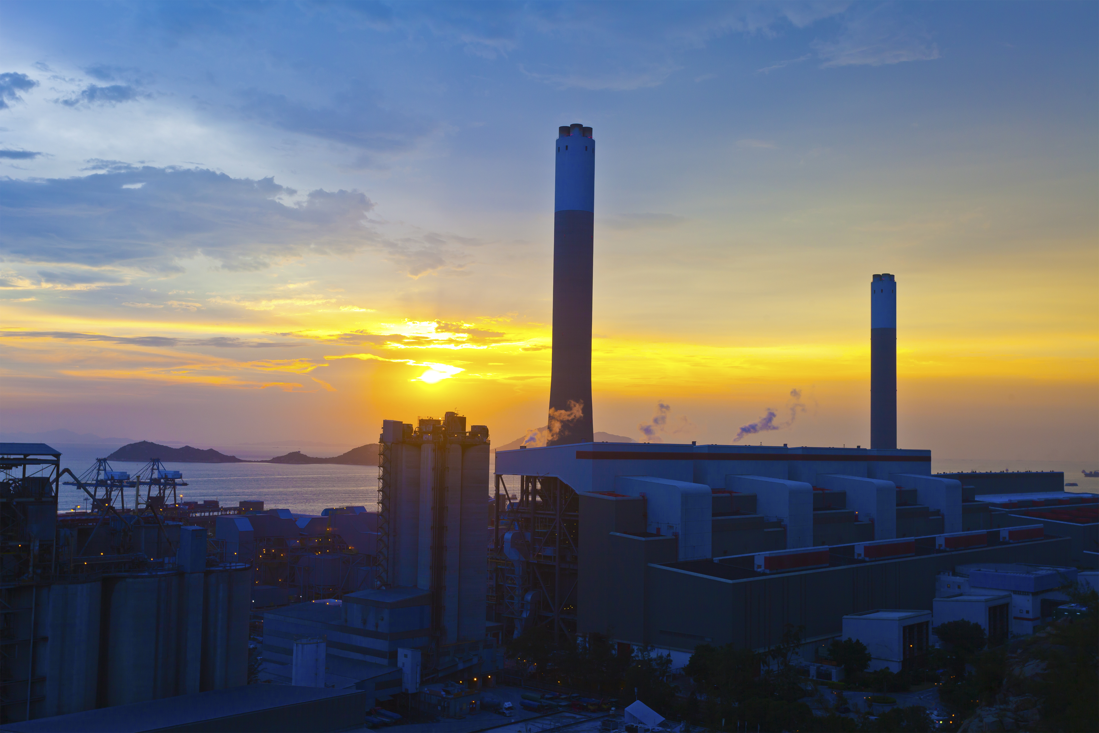 Thermal power boiler feed water treatment plant at sunset.